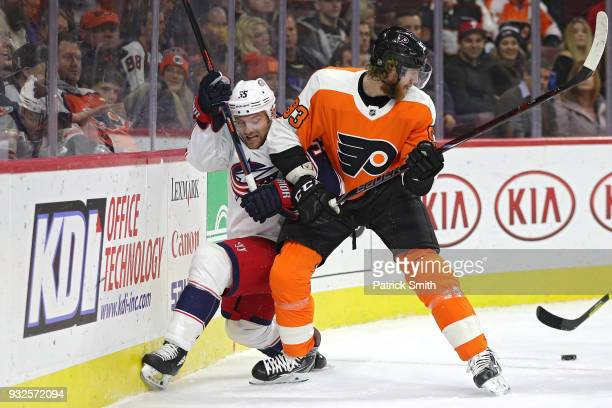 Mark Letestu of the Columbus Blue Jackets and Jakub Voracek of the Philadelphia Flyers battle for the puck during the first period at Wells Fargo...