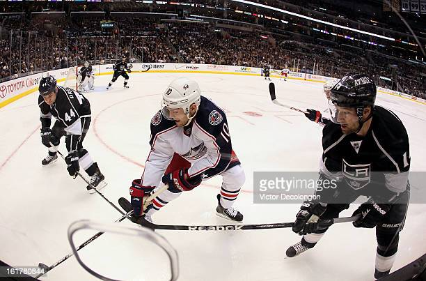 Mark Letestu of the Columbus Blue Jackets vies for the puck in the corner with Davis Drewiske and Justin Williams of the Los Angeles Kings during the...