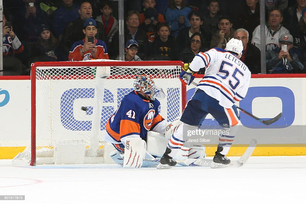 Mark Letestu #55 of the Edmonton Oilers scores a goal on Jaroslav Halak #41 of the New York Islanders in the shootout at the Barclays Center on November 5, 2016 in Brooklyn borough of New York City. The Oilers defeated the Islanders 4-3 in overtime.