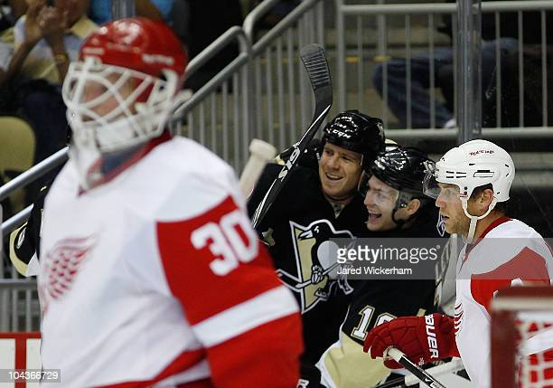 Mark Letestu of the Pittsburgh Penguins celebrates with teammate Ryan Craig after he scored in the first period against the Detroit Red Wings during...