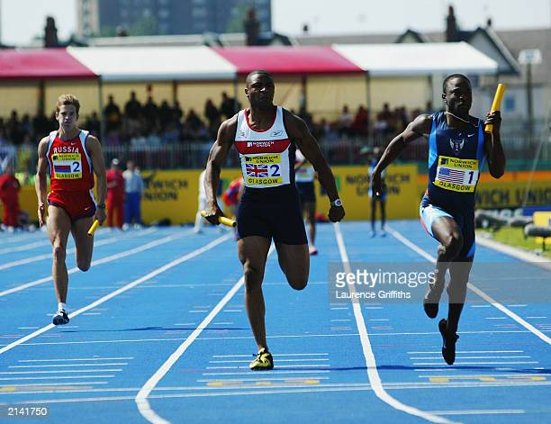Mark Lewis Francis of Great Britain and Aaron Armstrong of the USA in action in the Mens 4 X 100 Metre relay during the Norwich Union International...