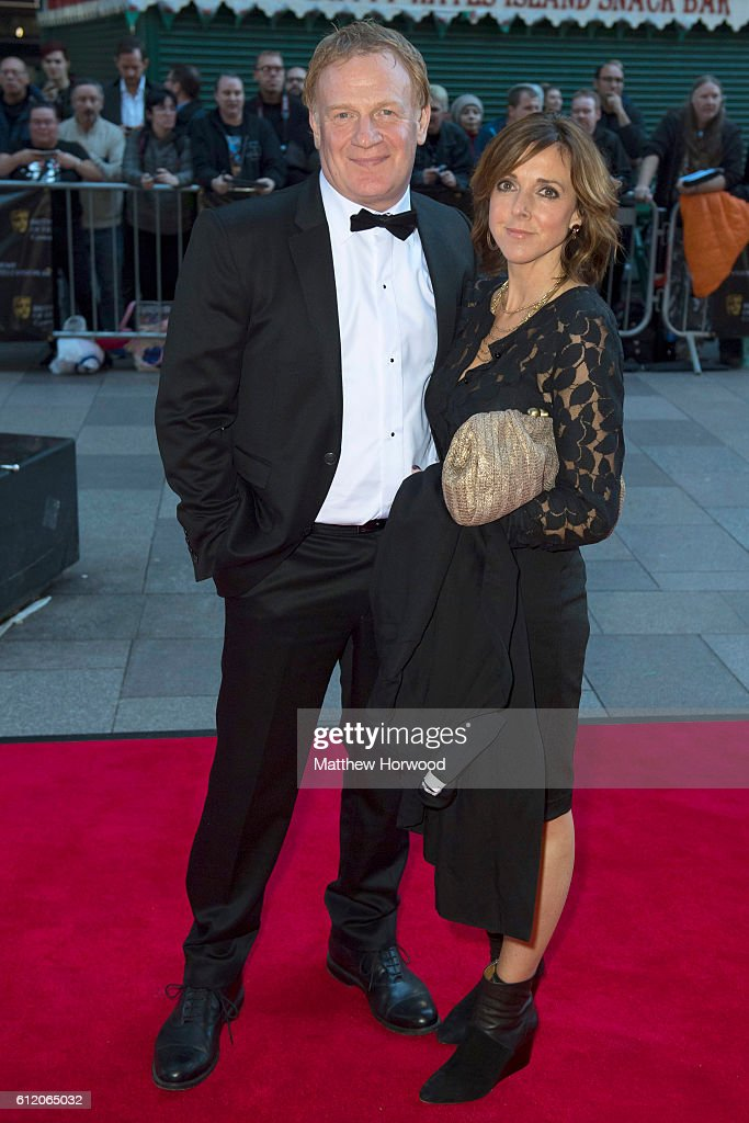 Mark Lewis Jones (L) arrives for the 25th British Academy Cymru Awards at St David's Hall on October 2, 2016 in Cardiff, Wales.