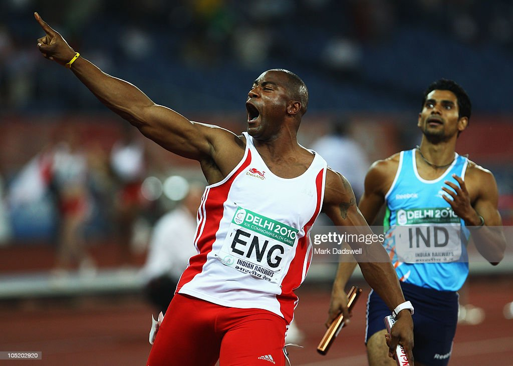 Mark Lewis-Francis of England celebrates as he crosses the finish line to claim gold during the men's 4 x 100 metres final at Jawaharlal Nehru Stadium during day nine of the Delhi 2010 Commonwealth Games on October 12, 2010 in Delhi, India.