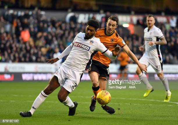 Mark Little of Bolton Wanderers and Diogo Jota of Wolverhampton Wanderers during the Sky Bet Championship match between Wolverhampton and Bolton...