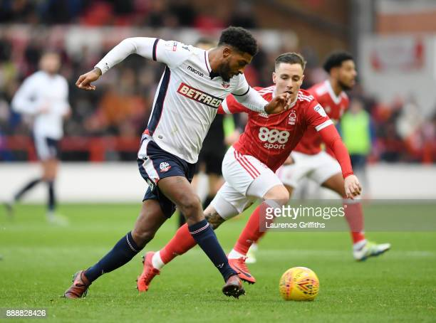 Mark Little of Bolton Wanderers gets to the ball ahead of Barrie McKay of Nottingham Forest during the Sky Bet Championship match between Nottingham...