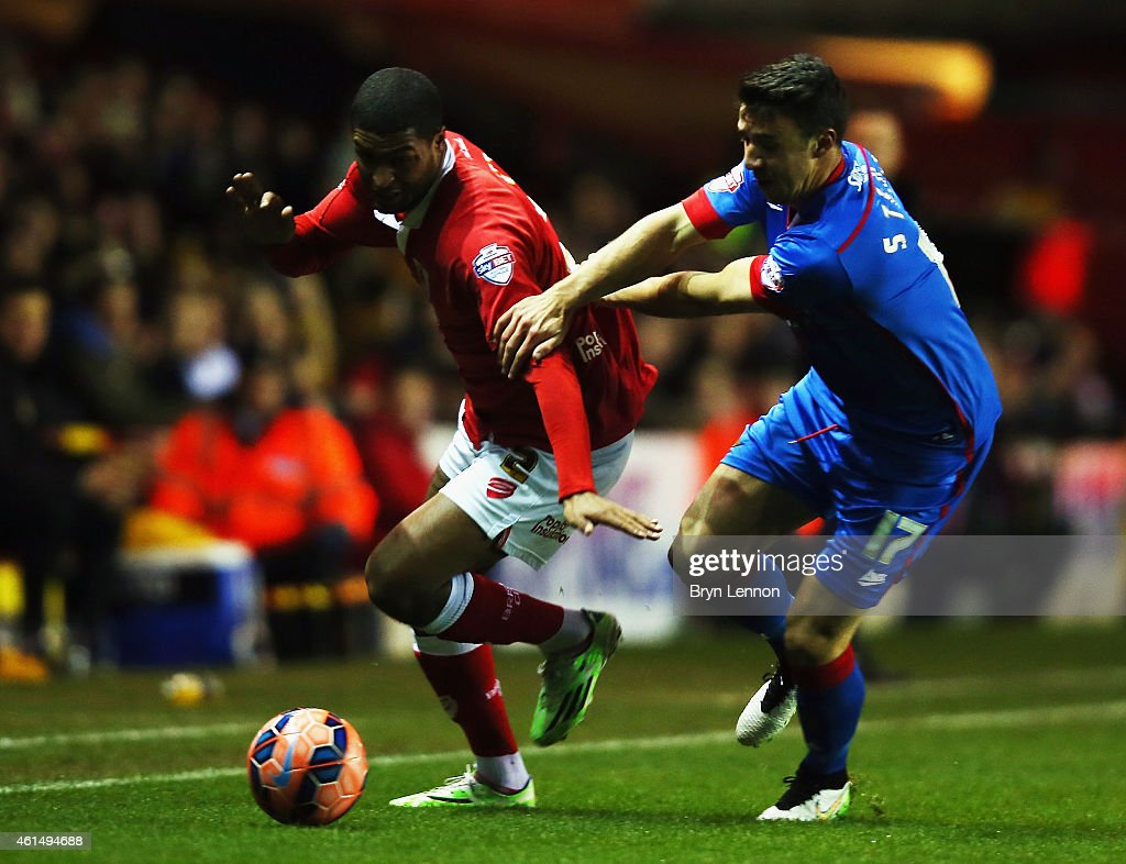 Mark Little of Bristol City avoids Enda Stevens of Doncaster Rovers during the FA Cup Third Round Replay between Bristol City and Doncaster Rovers at Ashton Gate on January 13, 2015 in Bristol, England.