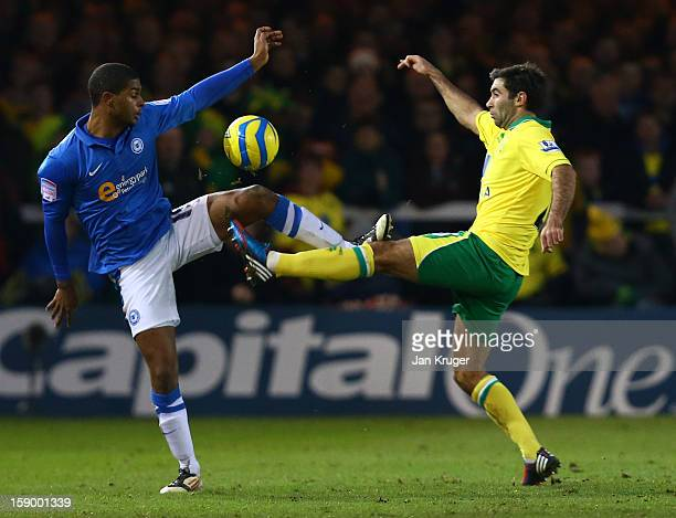 Mark Little of Peterborough United and Russell Martin of Norwich City fight for the ball during the FA Cup with Budweiser third round match between...