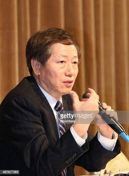 Mark Liu, co-chief executive officer and co-president of Taiwan Semiconductor Manufacturing Co. , gestures as he speaks during an earnings briefing...