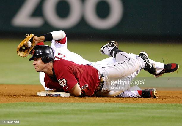 Mark Loretta of the Houston Astros is tagged out at second base by Orlando Cabrera of the Los Angeles Angels of Anaheim during Major League Baseball...