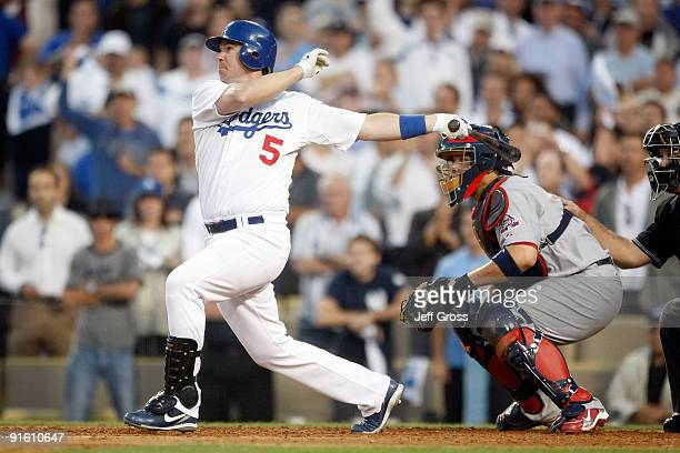 Mark Loretta of the Los Angeles Dodgers hits a walkoff RBI single to center to score Casey Blake to defeat the St Louis Cardinals in Game Two of the...