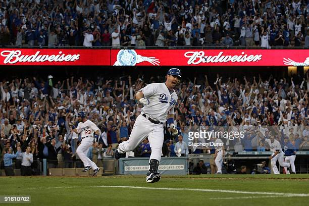 Mark Loretta of the Los Angeles Dodgers rounds first as he hits a walkoff RBI single to center to score Casey Blake to defeat the St Louis Cardinals...