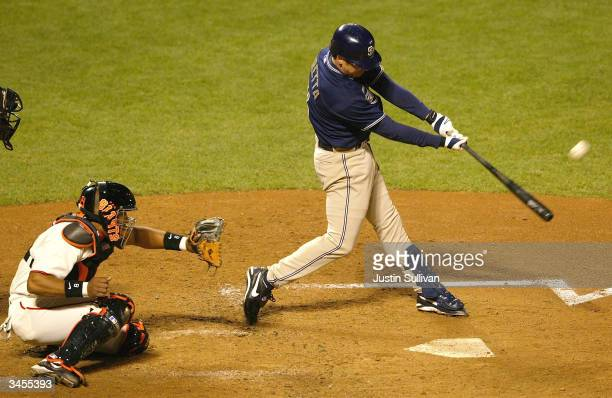 Mark Loretta of the San Diego Padres connects for a threerun home run during the third inning against the San Francisco Giants on April 21 2004 at...