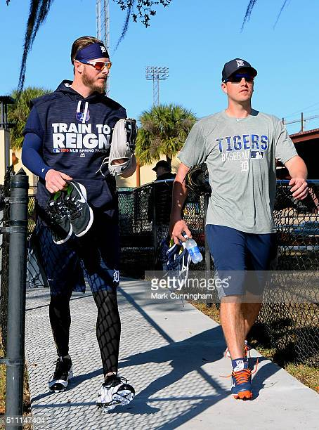 Mark Lowe and Jordan Zimmermann of the Detroit Tigers walk together to the practice fields during the Spring Training workout day at the TigerTown...