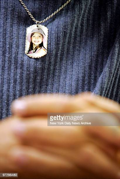 Mark Lunsford wears a photo of his daughter Jessica on a chain around his neck as he testifies at a New York State Senate hearing looking at whether...