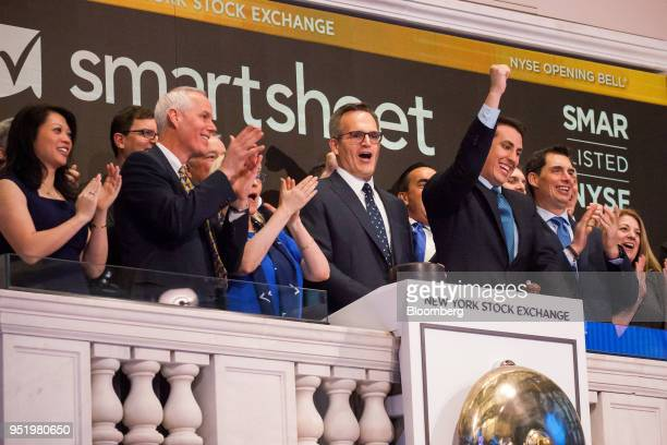 Mark Mader president and chief executive officer of Smartsheetcom Inc center rings the opening bell during the company's initial public offering on...