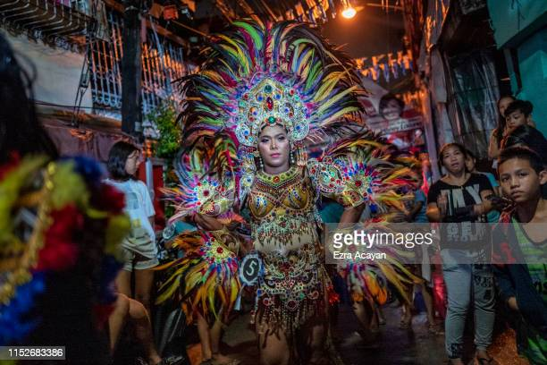Mark Magbanua waits in line in his national costume as he competes at a community gay beauty pageant to mark Pride Month on June 28 2019 in Manila...