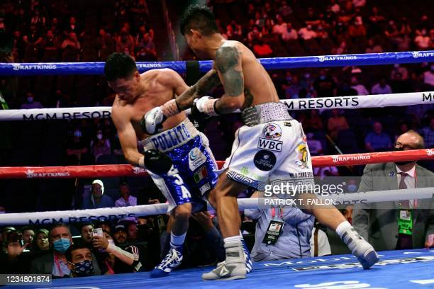 Mark Magsayo of the Philippines delivers a knockout punch to Julio Ceja of Mexico during the WBA Featherweight Title Eliminator boxing match at...