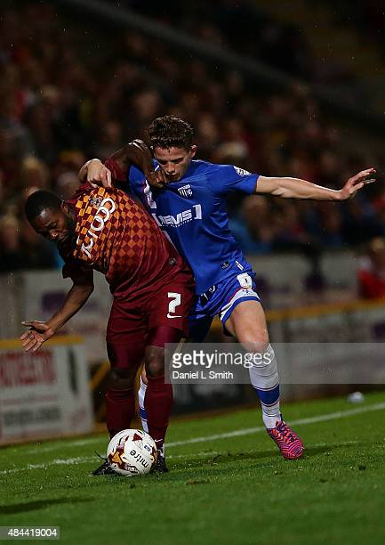 Mark Marshall of Bradford City AFC holds Jordan Houghton of Gillingham FC off the ball during the Sky Bet League One match between Bradford City AFC...