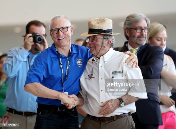 Mark Martin congratulates Jack Roush after Roush is voted into the Hall of Fame during the NACAR Hall of Fame Voting Day at NASCAR Hall of Fame on...
