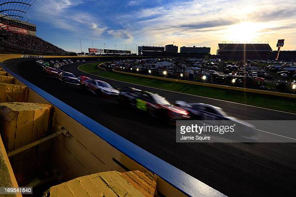 Mark Martin driver of the Aaron's Dream Machine Toyota and Jeff Gordon driver of the Drive To End Hunger Chevrolet lead the field on a restart during...
