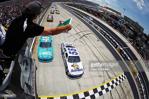 Mark Martin driver of the Aaron's Dream Machine Toyota and Jimmie Johnson driver of the Lowe's Madagascar Chevrolet lead the field to the green flag...
