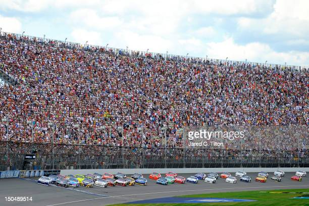 Mark Martin driver of the Aaron's Dream Machine Toyota leads the field to the start of the NASCAR Sprint Cup Series Pure Michigan 400 at Michigan...