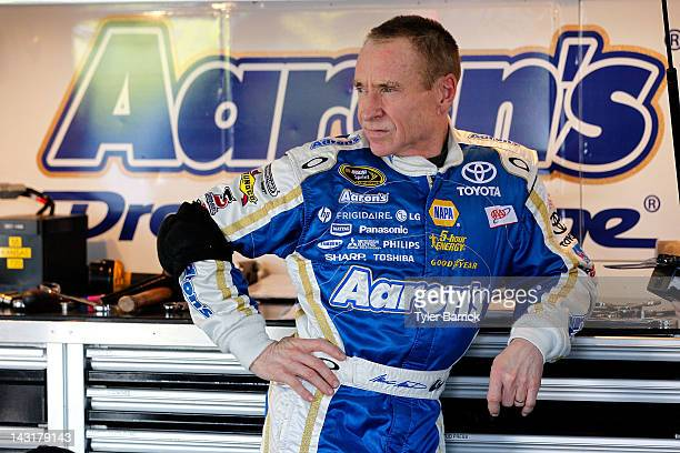 Mark Martin driver of the Aaron's Dream Machine Toyota looks on in the garage during practice for the NASACAR Sprint Cup Series 400 at Kansas...