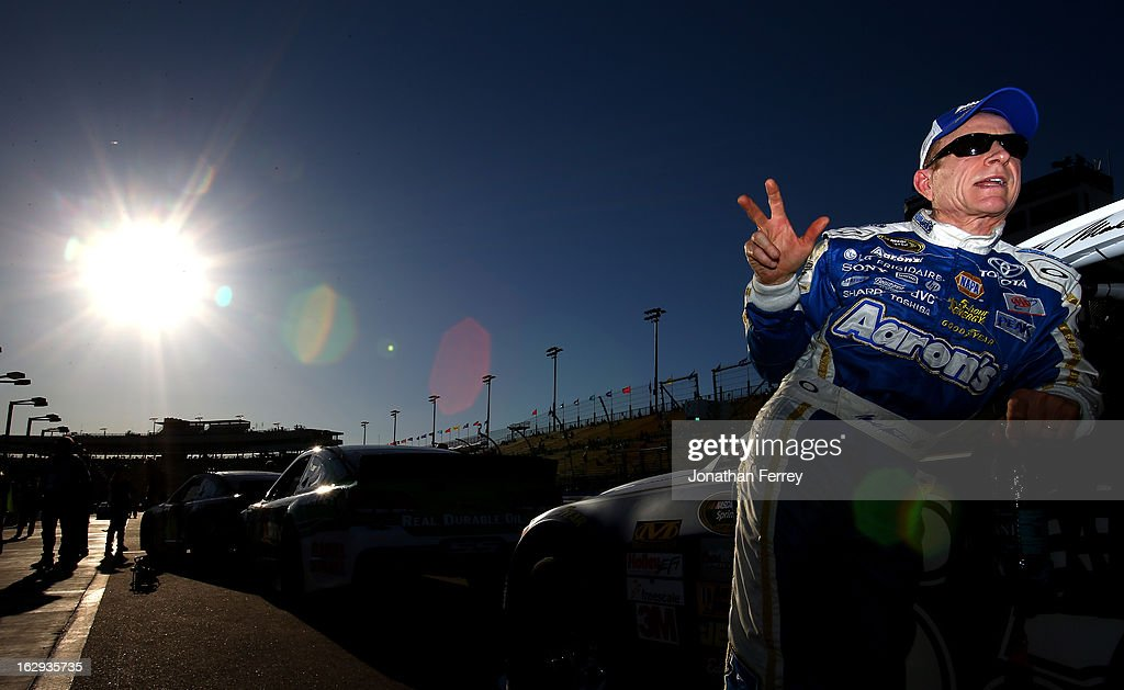 Mark Martin, driver of the #55 Aaron's Dream Machine Toyota, stands by his car on the grid during qualifying for the NASCAR Sprint Cup Series Subway Fresh Fit 500 at Phoenix International Raceway on March 1, 2013 in Avondale, Arizona.