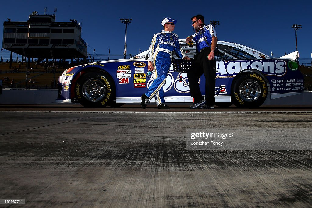 Mark Martin, driver of the #55 Aaron's Dream Machine Toyota, walks with crew chief Rodney Childers on the grid during qualifying for the NASCAR Sprint Cup Series Subway Fresh Fit 500 at Phoenix International Raceway on March 1, 2013 in Avondale, Arizona.