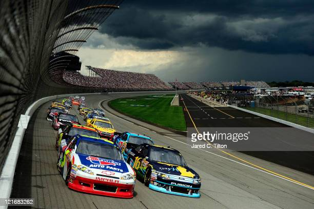 Mark Martin driver of the Carquest/GoDaddycom Chevrolet and Greg Biffle driver of the Pure Michigan Ford lead the field during the NASCAR Sprint Cup...