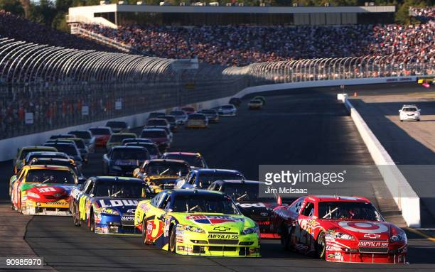 Mark Martin driver of the CARQUEST/Kellogg's Chevrolet and Juan Pablo Montoya driver of the Target Chevrolet lead the field late in the race during...