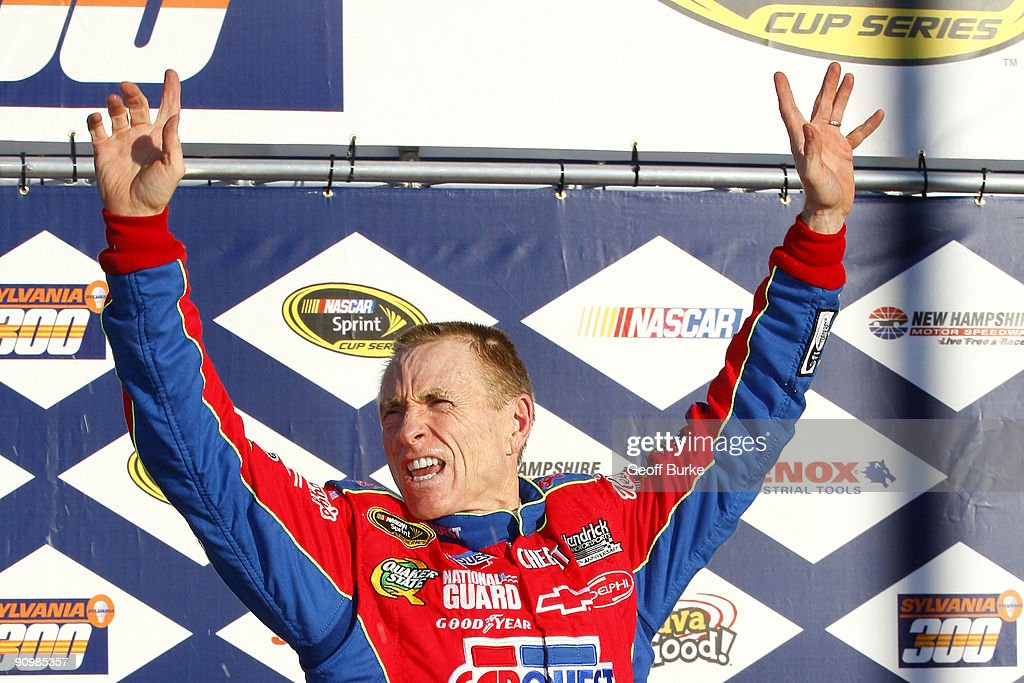 Mark Martin, driver of the #5 CARQUEST/Kellogg's Chevrolet, celebrates in victory lane after winnng the NASCAR Sprint Cup Series Sylvania 300 at the New Hampshire Motor Speedway on September 20, 2009 in Loudon, New Hampshire.