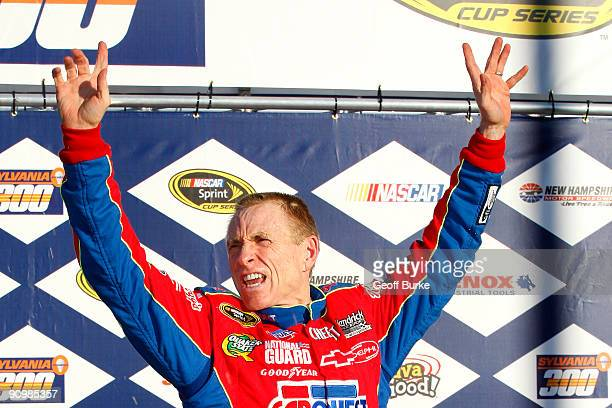 Mark Martin driver of the CARQUEST/Kellogg's Chevrolet celebrates in victory lane after winnng the NASCAR Sprint Cup Series Sylvania 300 at the New...