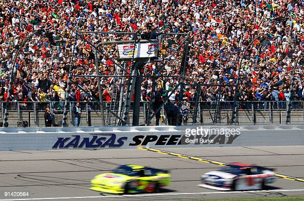 Mark Martin driver of the CARQUEST/Kellogg's Chevrolet leads Dale Earnhardt Jr driver of the National Guard/AMP Energy Chevrolet at the start of the...