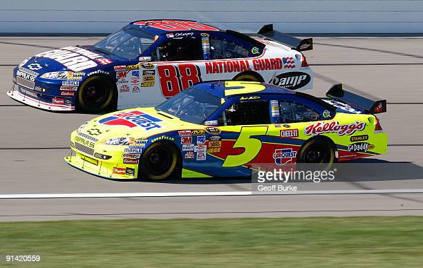 Mark Martin driver of the CARQUEST/Kellogg's Chevrolet races Dale Earnhardt Jr driver of the National Guard/AMP Energy Chevrolet during the NASCAR...