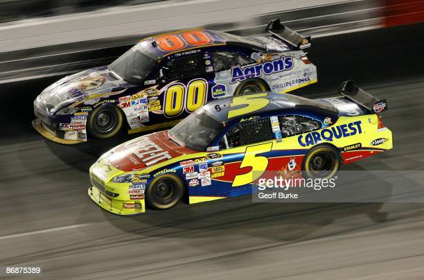 Mark Martin driver of the CheezIt/CARQUEST Chevrolet races David Reutimann driver of the Aaron's Dream Machine Toyota during the NASCAR Sprint Cup...