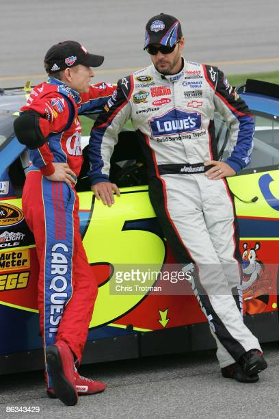 Mark Martin , driver of the Cheez-it/CARQUEST Chevrolet, talks with teammate Jimmie Johnson , driver of the Lowe's Chevrolet, during qualifying for...