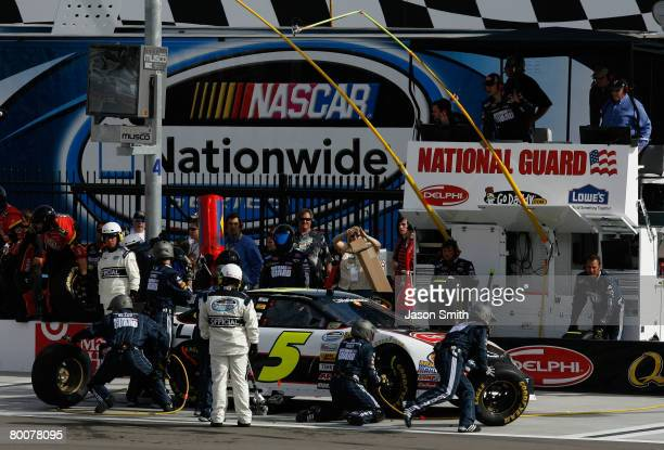 Mark Martin driver of the Delphi Chevrolet pits as team owner Rick Hendrick watches from the pit box during the NASCAR Nationwide Series Sam's Town...