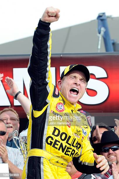 Mark Martin driver of the Dollar General Chevrolet celebrates in Victory Lane after winning the NASCAR Nationwide Series Sam's Town 300 at Las Vegas...