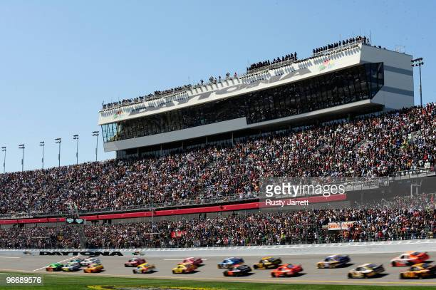 Mark Martin driver of the GoDaddycom Chevrolet and Dale Earnhardt Jr driver of the AMP Energy/National Guard Chevrolet lead the field at the start of...