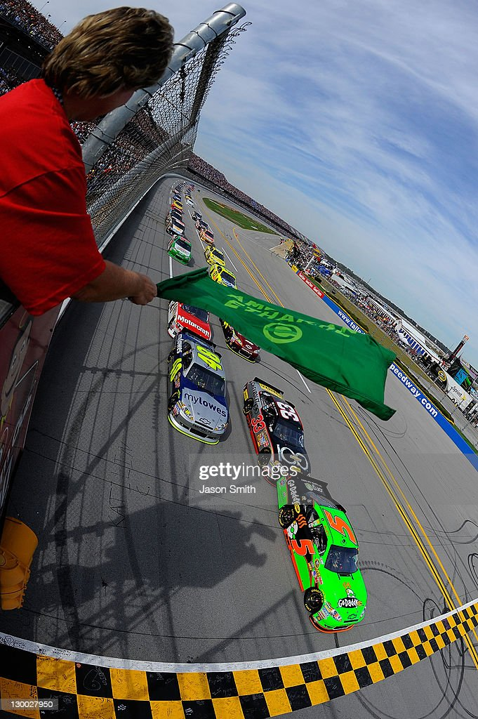 Mark Martin, driver of the #5 GoDaddy.com Chevrolet, and Jimmie Johnson, driver of the #48 MyLowe's Chevrolet, lead the field at the start of the NASCAR Sprint Cup Series Good Sam Club 500 at Talladega Superspeedway on October 23, 2011 in Talladega, Alabama.
