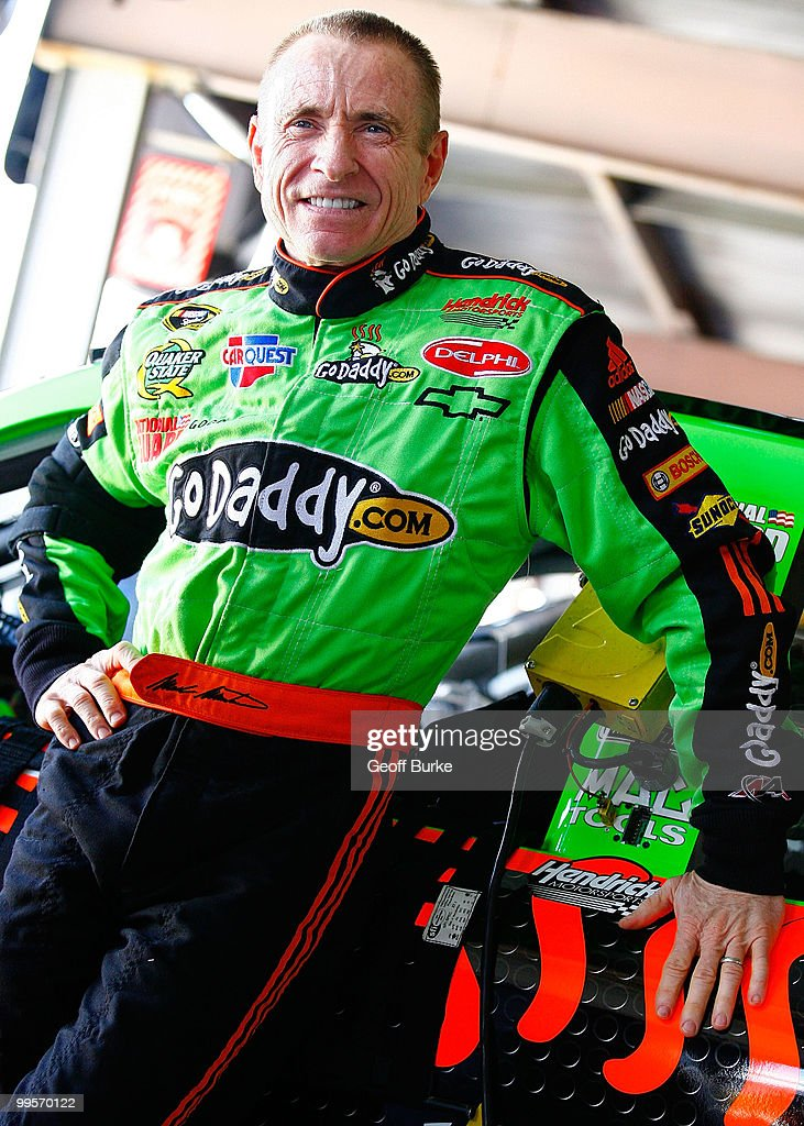 Mark Martin, driver of the #5 GoDaddy.com Chevrolet, stands in the garage during practice for the NASCAR Sprint Cup Series Autism Speaks 400 at Dover International Speedway on May 15, 2010 in Dover, Delaware.