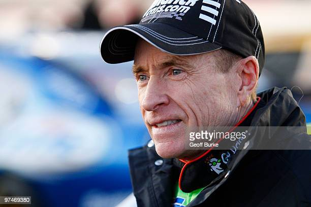 Mark Martin driver of the Hendrickcarscom/GoDaddycom Chevrolet gets out of his car after qualifying for the NASCAR Sprint Cup Series Kobalt Tools 500...