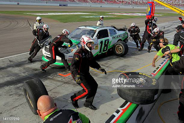 Mark Martin driver of the Interstate Batteries Toyota makes a pit stop during the NASCAR Nationwide Series Sam's Town 300 at Las Vegas Motor Speedway...