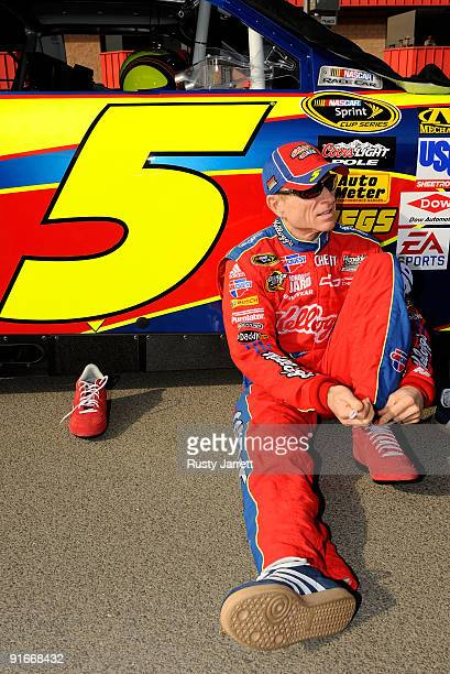 Mark Martin driver of the Kellogg's CarQuest Chevrolet Chevrolet changes his shoes on pit road during qualifying for the NASCAR Sprint Cup Series...