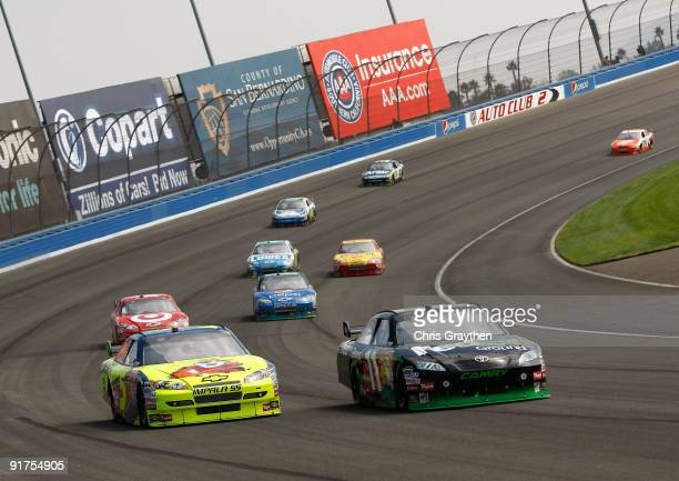 Mark Martin driver of the Kellogg's Chevrolet battles Denny Hamlin driver of the FedEx Toyota during the NASCAR Sprint Cup Series Pepsi 500 at Auto...
