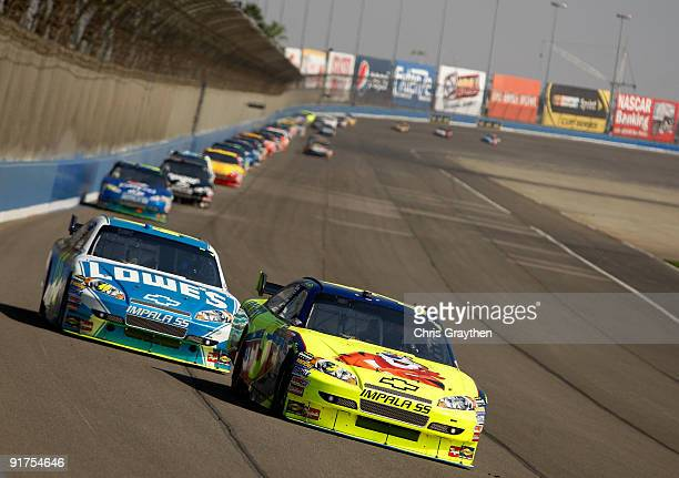 Mark Martin driver of the Kellogg's Chevrolet leads Jimmie Johnson driver of the Lowe's Chevrolet during the NASCAR Sprint Cup Series Pepsi 500 at...