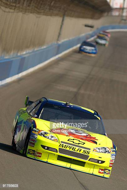 Mark Martin driver of the Kellogg's Chevrolet races during the NASCAR Sprint Cup Series Pepsi 500 at Auto Club Speedway on October 11 2009 in Fontana...