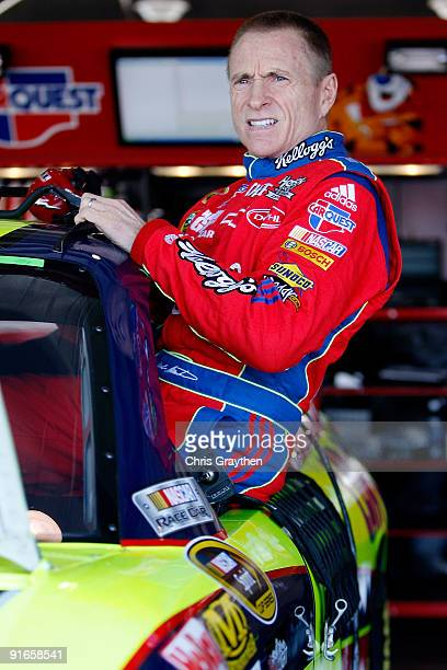 Mark Martin driver of the Kellogg's/CARQUEST Chevrolet climbs into his car during practice for the NASCAR Sprint Cup Series Pepsi 500 at Auto Club...