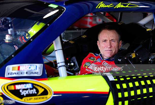 Mark Martin driver of the Kellogg's/CARQUEST Chevrolet waits in his car during practice for the NASCAR Sprint Cup Series Pepsi 500 at Auto Club...